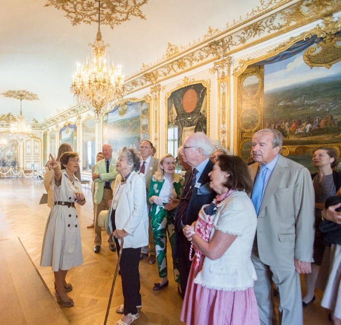 Guests admire the Grand Condé's military victories in the Gallery of Actions
