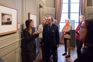 """L-R: Nicole Garnier, Ariane Dandois, Louis-Antoine Prat, Irène Chardon, Ondine de Rothschild, and Susan Kendall looking at Rembrandt's """"Paysage aux trois arbres."""""""