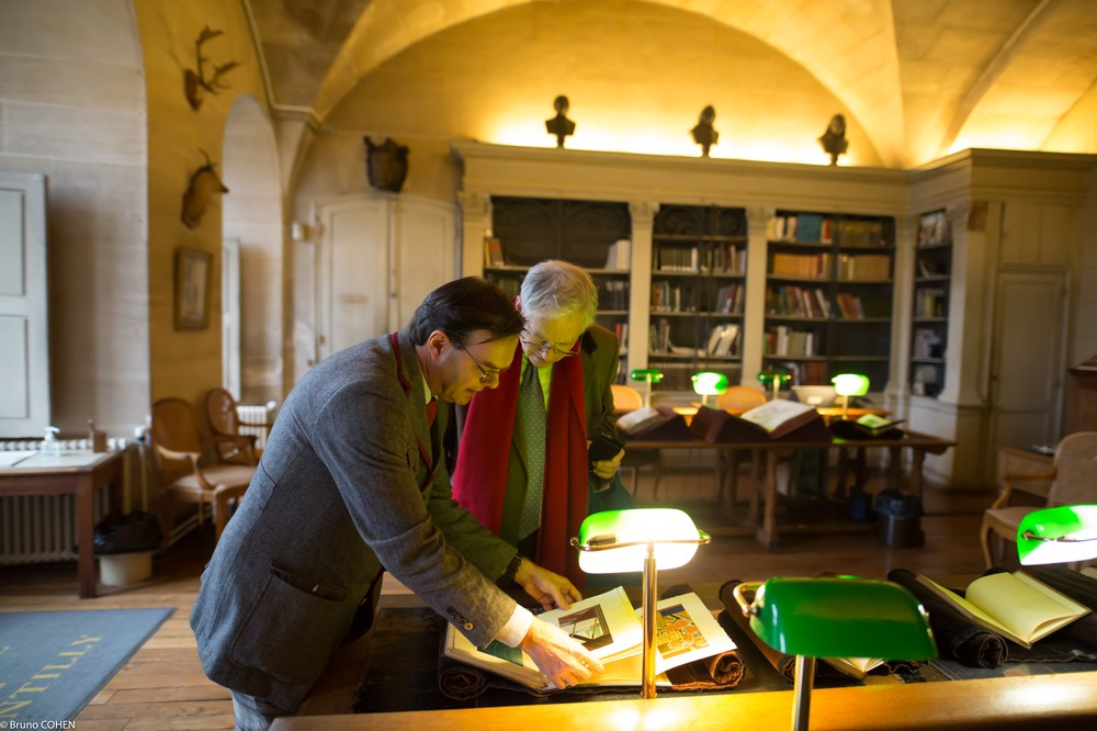 Laurent Ferri with Hinrich Sieveking looking through some of the Duke d'Aumale's literary treasures.