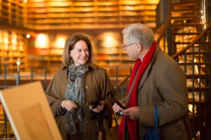 Alice Goldet, FODC Board member, and Hinrich Sieveking discussing the works of art.