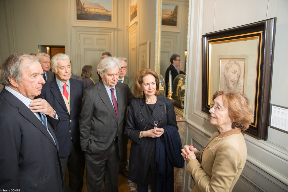 Chief Curator Nicole Garnier describes a portrait of Christ as Christian Langlois-Meurinne, Thierry Normand, Olivier Bourgois, and Alice Goldet listen attentively