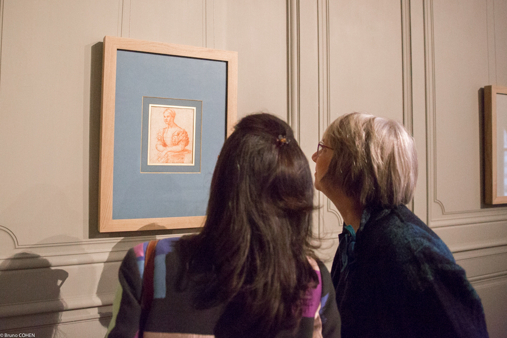 Cristiana Romalli and Jane Shoaf Turner study a portrait of a young girl from 16th-century Tuscany