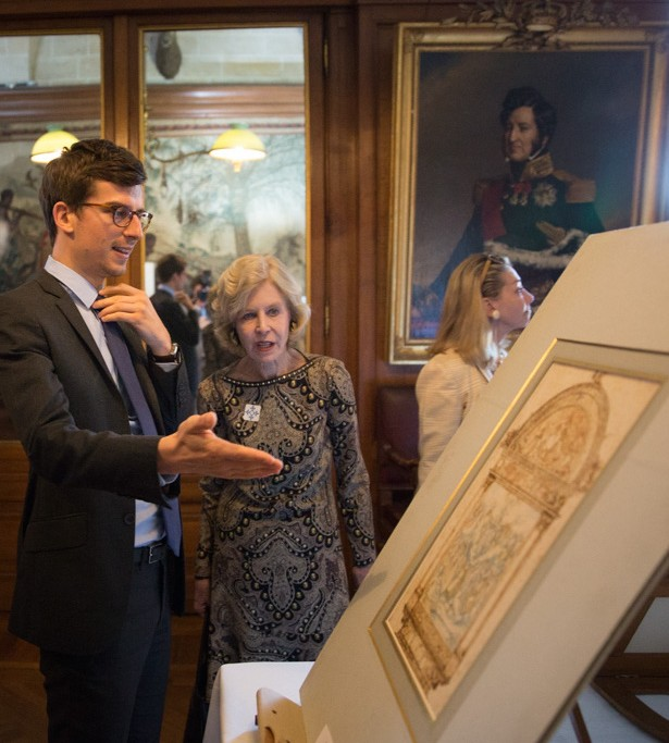 Curator Mathieu Deldicque and Ann Nitze discuss a drawing during a private viewing