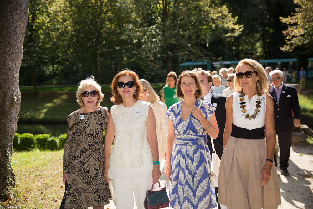 Ann Nitze, Sana Sabbagh, Caroline de Navacelle, and Elsbeth Van Tets arrive in the Anglo-Chinese garden to enjoy an aperitif