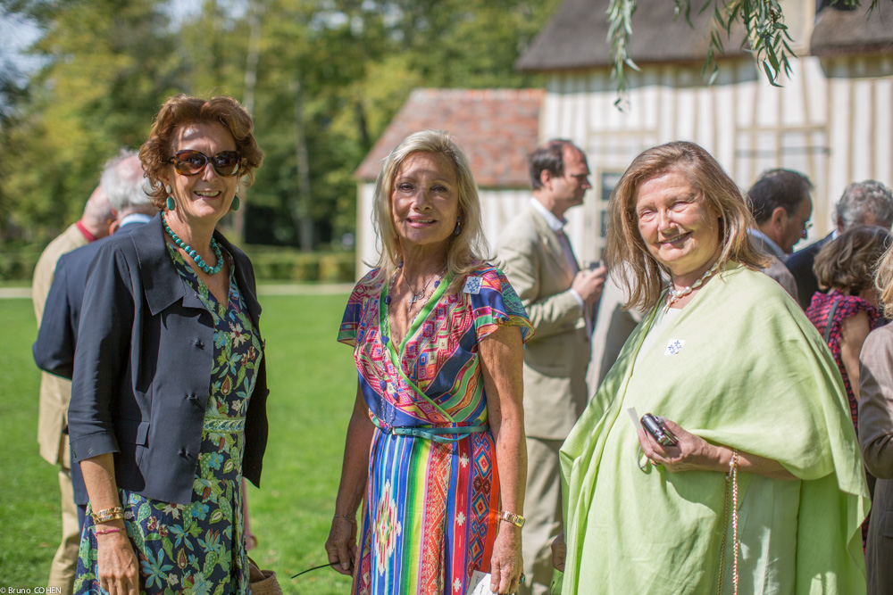 Nathalie Brunel, Baroness Sylvie de Waldner, and Baroness Carole de Cabrol enjoy a moment before lunch is served in the Hameau