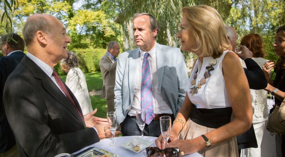 Prince Amyn Aga Khan, Thomas Leysen, and Elsbeth Van Tets enjoy hors d'oeuvres