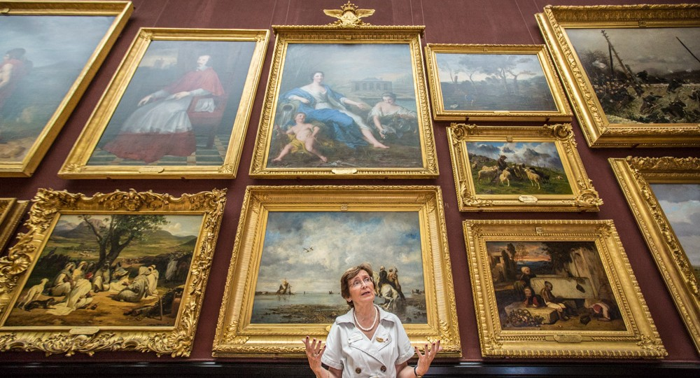 Chief Curator Nicole Garnier in front of masterpieces of French painting