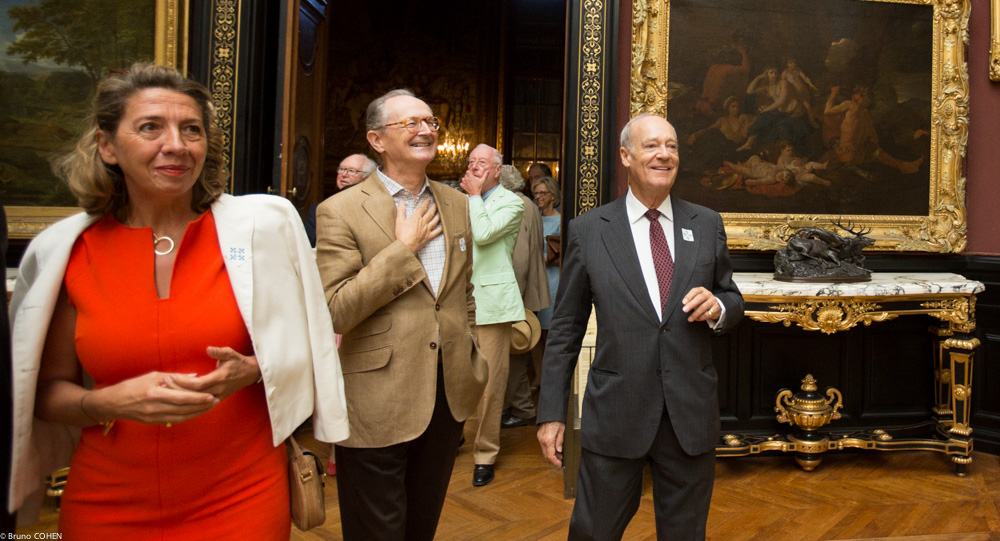 Aude Ergmann, Pierre Guénant, and Prince Amyn Aga Khan marvel at the artworks in the Gallery of Paintings