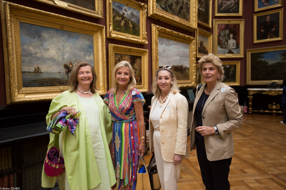 Baroness Carole de Cabrol, Baroness Sylvia de Waldner, Susan Gutfreund, and Countess Isabelle de Viel Castel surrounded by masterpieces in the Gallery of Paintings