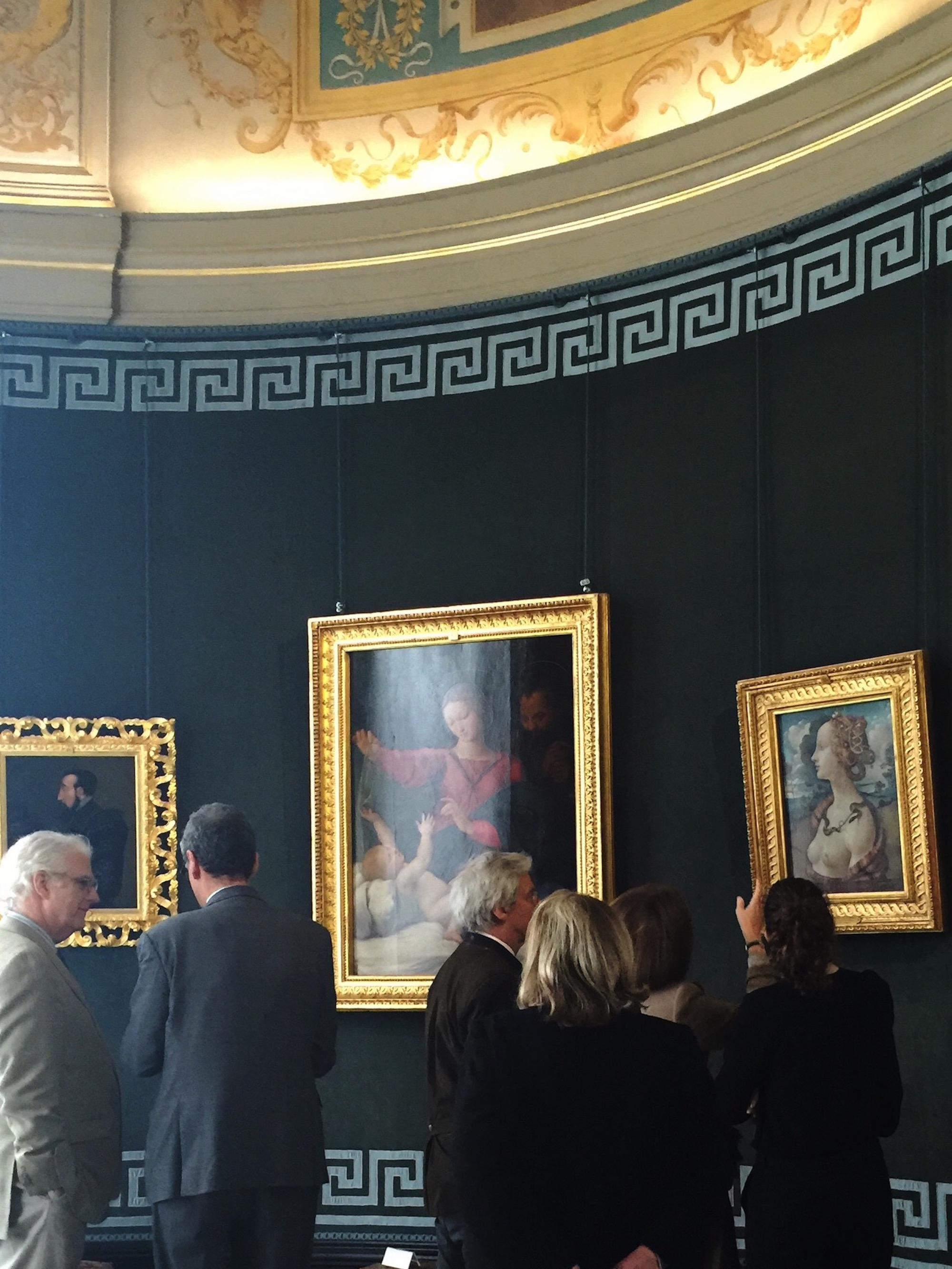 Alexander Johnson, Henri Loyrette, Olivier Bourgois, Maryvonne Pinault, Alice Goldet, and Astrid Grange in the Rotunda admiring Italian Renaissance pictures