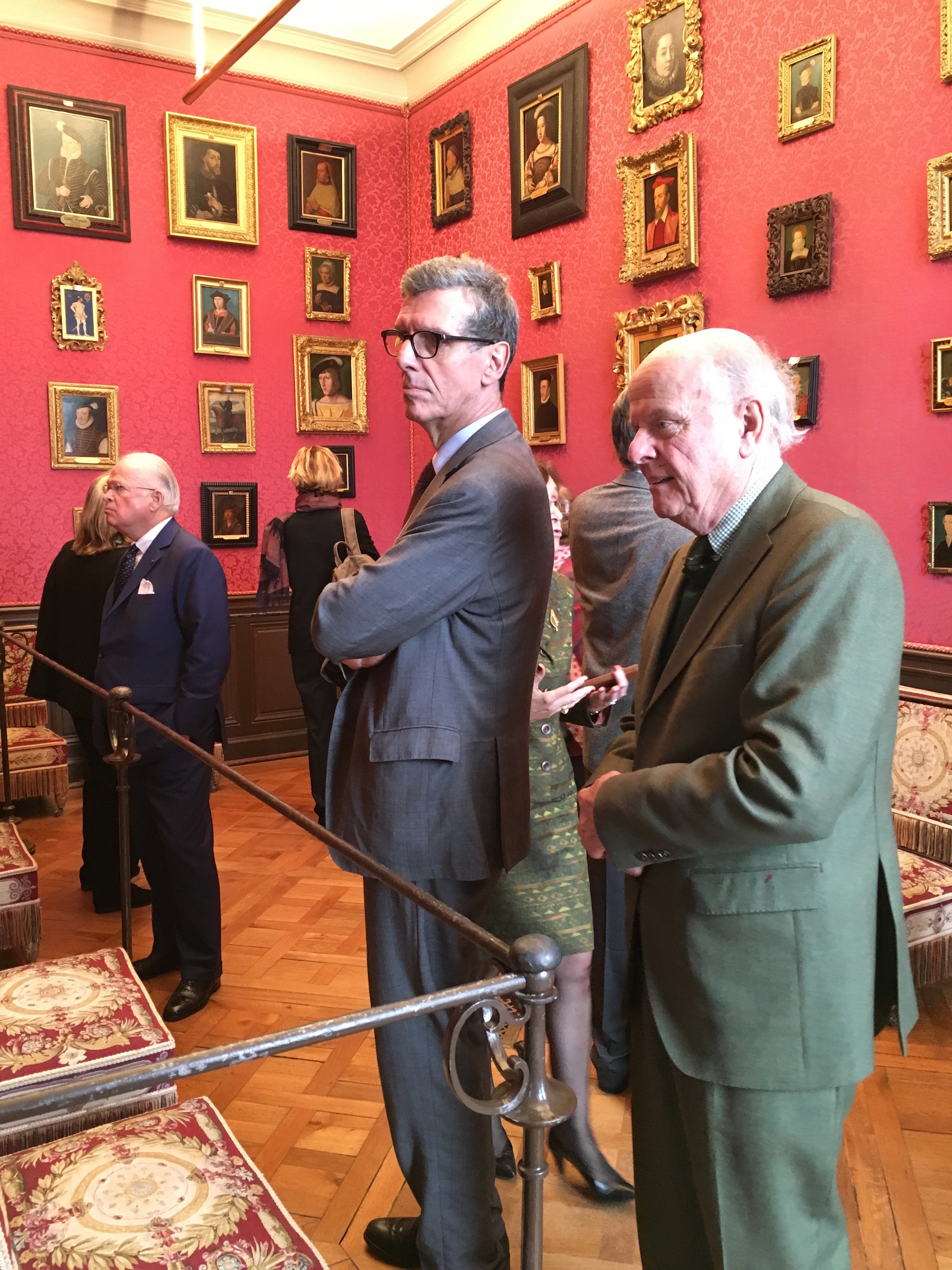 Jean Bonna, Henri Loyrette, Comte Jean de Rohan Chabot, and other guests observe 16th-century French portraits in the Clouet Room