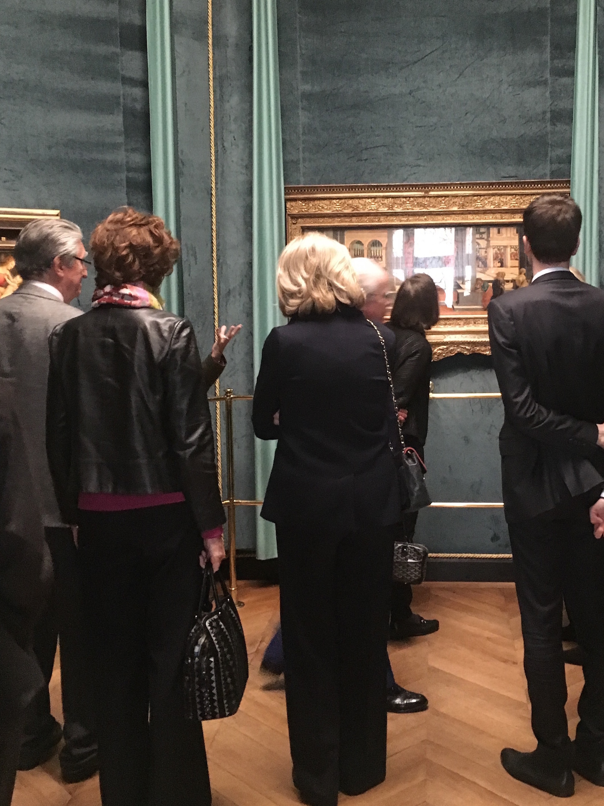 "Guests admire ""King Ahasuerus Choosing Esther"" by Filippino Lippi in the Sanctuary"