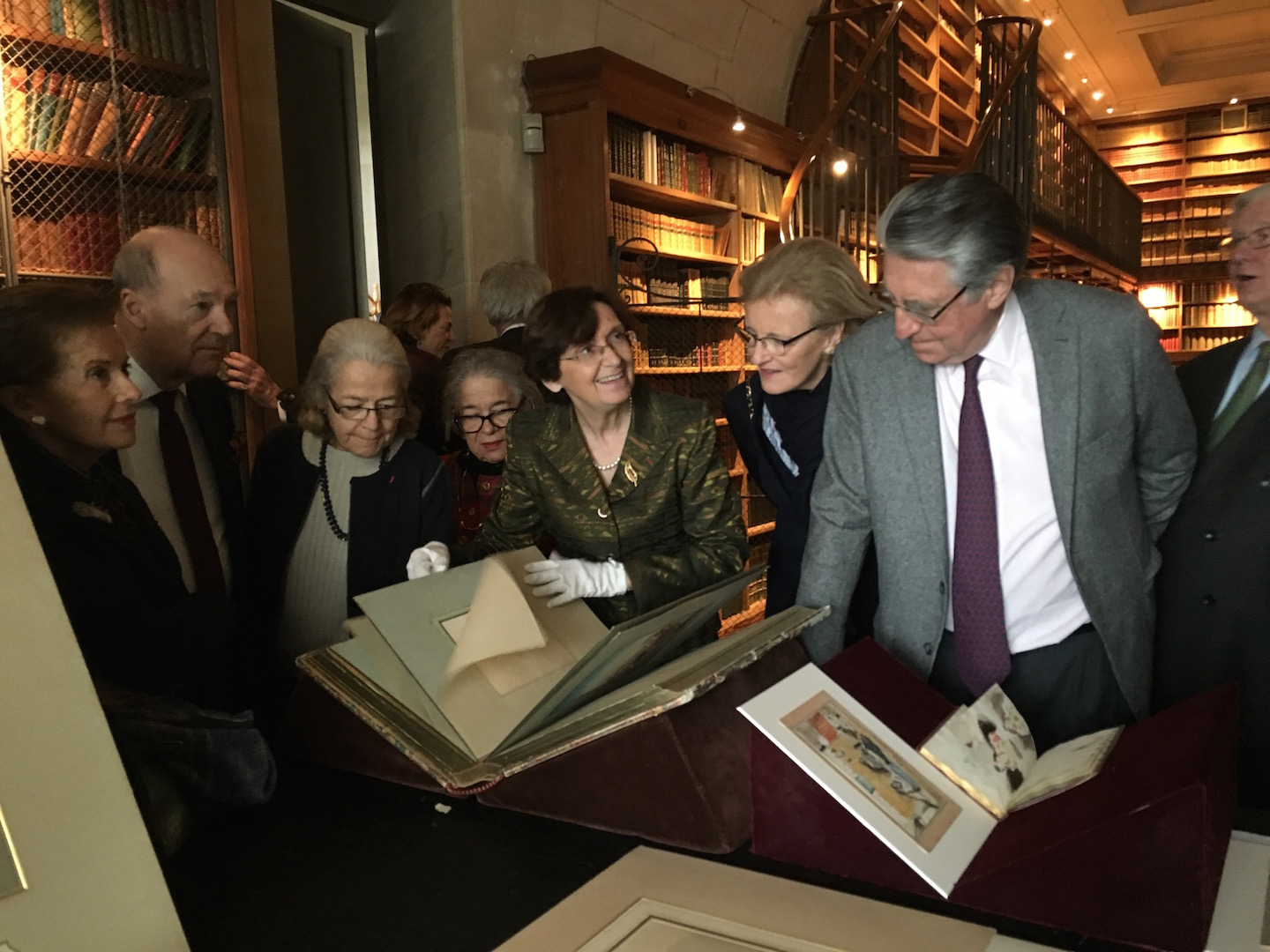 Nicole Garnier, curator in charge of the Musée Condé, sharing drawings with guests in the Bibliothèque du Théâtre, the Duke d'Aumale's private study (L to R: Marie-France Pochna, Prince Amyn Aga Khan, Nicole Salinger, Garance Aufaure, Nicole Garnier, Baronne Antoinette Seillière, Baron Ernest-Antoine Seillière, and Vicomte Olivier de Rohan)